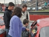 16 year-old #12 Derek Griffith shows a young fan the inside of his Pro Stock at an GSPSS meet and greet at Riverside Speedway